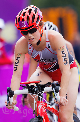 04 AUG 2012 - LONDON, GBR - Paula Findlay (CAN) of Canada rides in a pack during the women's London 2012 Olympic Games Triathlon in Hyde Park, London, Great Britain .(PHOTO (C) 2012 NIGEL FARROW)