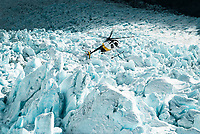 A helicopter's flying over crevasses and seracs on the Franz Josef Glacier - Westland National Park