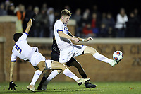 WINSTON-SALEM, NC - DECEMBER 07: William Gillingham #6 of the University of California Santa Barbara clears the ball defensively during a game between UC Santa Barbara and Wake Forest at W. Dennie Spry Stadium on December 07, 2019 in Winston-Salem, North Carolina.