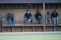 A coach throws batting practice as pro scouts observe the Spartanburg Methodist College Pioneers during a fall workout on Pro Day on Thursday, October 1, 2020, at Mooneyham Field in Spartanburg, South Carolina. (Tom Priddy/Four Seam Images)