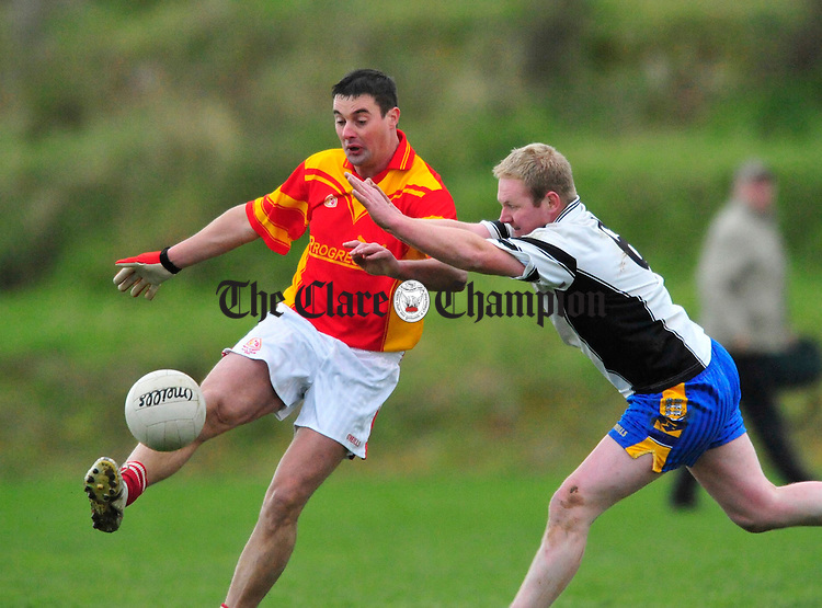Ennistymon's Willie Curtin closes down Kevin Mc Carthy of Smith O' Brien. Photograph by Declan Monaghan