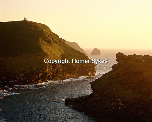 Iron Age promontory Hillfort, Willapark. Boscastle, Cornwall, England. Celtic Britain published by Orion. Now surmounted by a white washed look out tower, depicted by Turner in 1827.