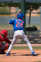 Chicago Cubs infielder Reivaj Garcia (24) at bat during an Extended Spring Training game against the Los Angeles Angels at Sloan Park on April 14, 2018 in Mesa, Arizona. (Zachary Lucy/Four Seam Images)
