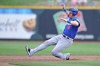 Allan Dykstra #10 of the Las Vegas 51s slides into second base against the Omaha Storm Chasers at Werner Park on August 17, 2014 in Omaha, Nebraska. The Storm Chasers  won 4-0.   (Dennis Hubbard/Four Seam Images)