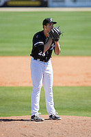 Kannapolis Intimidators relief pitcher Yelmison Peralta (28) looks to his catcher for the sign against the Delmarva Shorebirds at Kannapolis Intimidators Stadium on April 13, 2016 in Kannapolis, North Carolina.  The Intimidators defeated the Shorebirds 8-7.  (Brian Westerholt/Four Seam Images)