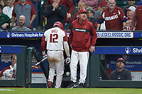Arkansas Razorbacks head coach Dave Van Horn lets the home plate umpire know he does not like his strike zone as Casey Opitz (12) walks back to the dugout during the game against the Baylor Bears in game nine of the 2020 Shriners Hospitals for Children College Classic at Minute Maid Park on March 1, 2020 in Houston, Texas. The Bears defeated the Razorbacks 3-2. (Brian Westerholt/Four Seam Images)