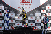 #10: Alex Palou, Chip Ganassi Racing Honda, #26: Colton Herta, Andretti Autosport w/ Curb-Agajanian Honda, #51: Romain Grosjean, Dale Coyne Racing with RWR Honda, podium, champagne