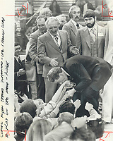 1980 FILE PHOTO - ARCHIVES -<br /> <br /> Thanks for No: Quebec Liberal Leader Claude Ryan leans down from stage at his victory celebration in Montreal to kiss the hands of supporters who helped his No forces win decisively in yesterday's referendum on sovereignity-association. The No scored 60 per cent of vote.<br /> <br /> 1980<br /> <br /> PHOTO :  Dick Loeb - Toronto Star Archives - AQP