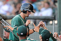 Second baseman Avery Romero (1) of the Greensboro Grasshoppers is congratulated after scoring a run in a game against the Greenville Drive on Wednesday, May 7, 2014, at Fluor Field at the West End in Greenville, South Carolina. Romero is the No. 9 prospect of the Miami Marlins, according to Baseball America. Greenville won, 12-8. (Tom Priddy/Four Seam Images)