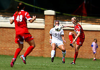 WINSTON-SALEM, NORTH CAROLINA - September 01, 2013:<br /> Kim Sharo (13) of Louisville University passes to Megan Berberich (49) against Wake Forest University during a match at the Wake Forest Invitational tournament at Wake Forest University on September 01. The match was abandoned early in the second half due to severe weather with Wake leading 1-0.