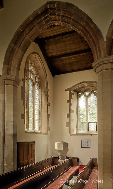 The font or baptismal basin in the north-west corner of the Parish Church of St. Nicholas in Fyfield, Oxfordshire, UK. The placing of the font has been queried as most fonts were placed near the main door of the church. The church was rebuilt after being almost destroyed by fire in 1893.