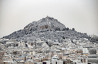 Pictured: The snow covered Lycabetus Hill, Athens, Greece. Tuesday 10 January 2017<br />