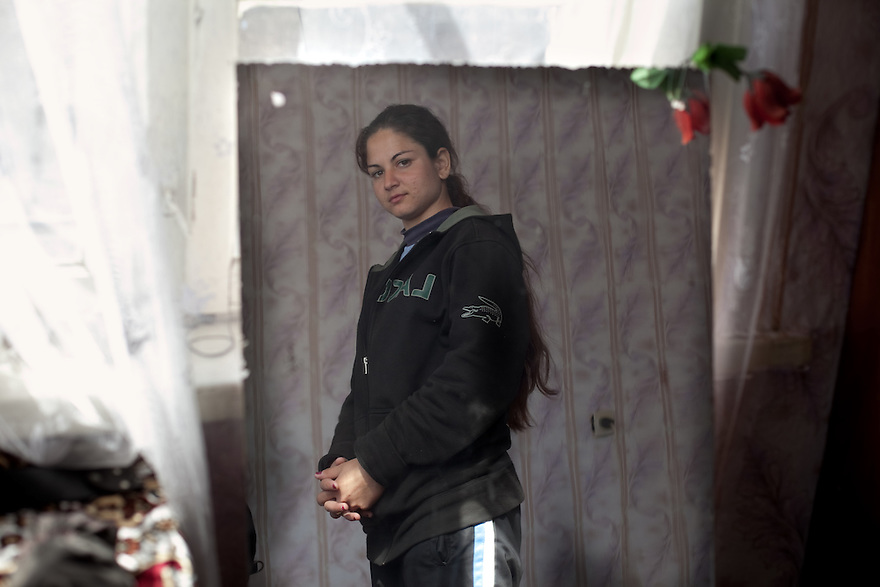 Prohorovo, Bulgaria--Todorka Dimitrova, 18, in her bedroom. She is a  member of the Kalaidzhi, a subset of the Roma people whose 20,000 are dispersed throughout Bulgaria.