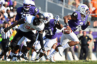 TCU quarterback Trevone Boykin (2) runs away from Oklahoma State defensive end Jimmy Bean (92) during an NCAA football game, Saturday, October 18, 2014 in Fort Worth, Tex. TCU leads Oklahoma State 28-9 at the halftime. (Mo Khursheed/TFV Media via AP Images)