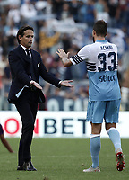 Football, Serie A: S.S. Lazio - Fiorentina, Olympic stadium, Rome, 7 ottobre 2018. <br /> Lazio's coach Simone Inzaghi (l) celebrates with his players Francesco Acerbi (r) after winning 1-0 the Italian Serie A football match between S.S. Lazio and Fiorentina at Rome's Olympic stadium, Rome on October 7, 2018.<br /> UPDATE IMAGES PRESS/Isabella Bonotto
