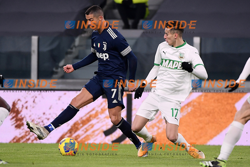 Cristiano Ronaldo of Juventus FC and Mert Muldur of US Sassuolo compete for the ball during the Serie A football match between Juventus FC and US Sassuolo Calcio at Allianz stadium in Torino (Italy), January 10th, 2021. Photo Federico Tardito / Insidefoto