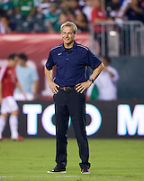 USMNT coach Jurgen Klinsmann watches his team before the game at Lincoln Financial Field in Philadelphia, PA. The USMNT tied Mexico, 1-1.