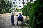 Father Laborde speaks with a diabled man in Asha Neer, Howrah. West Bengal, India, Arindam Mukherjee/Agency Genesis