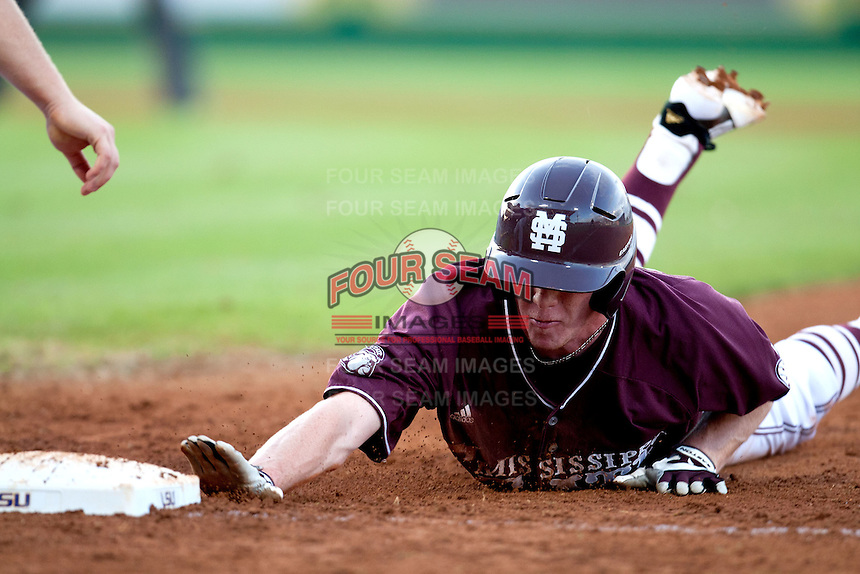 Mississippi State second baseman Matthew Britton #15 dives back to first base against the LSU Tigers during the NCAA baseball game on March 17, 2012 at Alex Box Stadium in Baton Rouge, Louisiana. The 10th-ranked LSU Tigers beat #21 Mississippi State, 4-3. (Andrew Woolley / Four Seam Images).