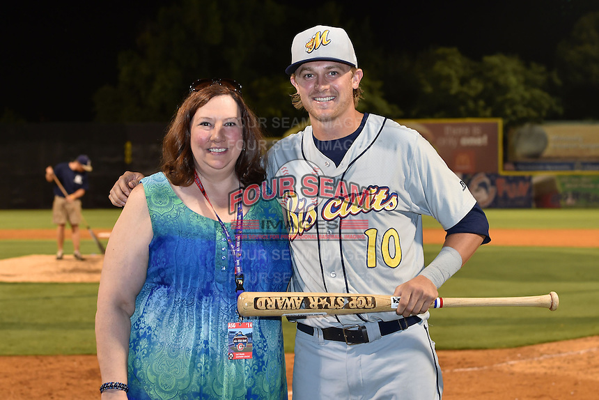 Montgomery Biscuits right fielder Tyler Motter #10 receives the Top Star Award from League President Lori Webb after the Southern League All Star game at AT&T Field on June 17, 2014 in Chattanooga, Tennessee. The Southern Division defeated the Northern Division 6-4. (Tony Farlow/Four Seam Images)