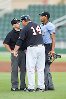 Home plate umpire Ronnie Whiting tries to break up the argument between Kannapolis Intimidators manager Pete Rose Jr. (14) and base umpire Rich Grassa during the game against the Lakewood BlueClaws at CMC-NorthEast Stadium on July 20, 2014 in Kannapolis, North Carolina.  The Intimidators defeated the BlueClaws 7-6. (Brian Westerholt/Four Seam Images)