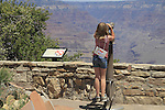 Girl looking through a telescope, South Rim of Grand Canyon National Park, Grand Canyon Village, northern Arizona. John offers private photo tours in Grand Canyon National Park and throughout Arizona, Utah and Colorado. Year-round.