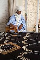 Silversmith Adam Zidia, a Tuareg from Agadez, Niger, offering Silver Jewelry at Biannual Arts Festival, Goree Island, Senegal