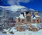 Saint Catherine of Sienna Chapel at St. Malo, sits quietly in the snow below Mt. Meeker along the Peak to Peak Scenic and Historic Byway, near Estes Park, Colorado, USA