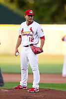 Richard Castillo (12) of the Springfield Cardinals stands on the mound during a game against the Northwest Arkansas Naturals at Hammons Field on June 14, 2012 in Springfield, Missouri. (David Welker/Four Seam Images)..