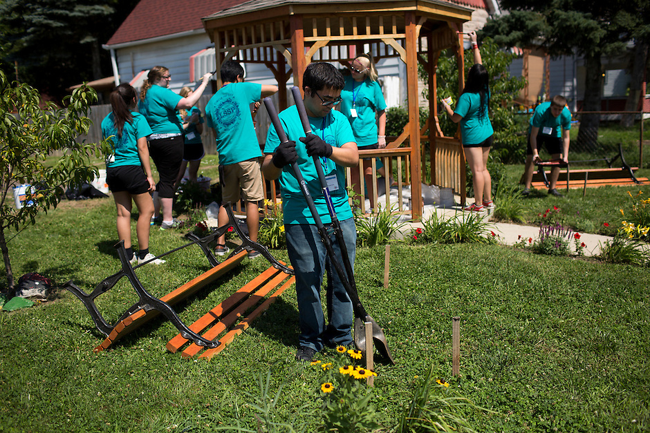 """Kevin Goble digs a hole for a bench leg during """"Circle the City with Service,"""" the Kiwanis Circle K International's 2015 Large Scale Service Project, on Wednesday, June 24, 2015, in Indianapolis. (Photo by James Brosher)"""
