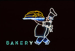 Vintage neon sign depicting a baker with a tray of breads outside Canter's Delicatessan on Fairfax Ave. in Los Angeles, CA.