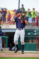 Bowing Green Hot Rods catcher Daniel De La Calle warms up the pitcher in between innings during a game against the Burlington Bees on May 7, 2016 at Community Field in Burlington, Iowa.  Bowling Green defeated Burlington 11-1.  (Mike Janes/Four Seam Images)