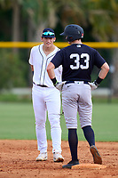 FCL Tigers West shortstop Izaac Pacheco (35) talks with Trey Sweeney (33) during a game against the FCL Yankees on July 31, 2021 at Tigertown in Lakeland, Florida.  (Mike Janes/Four Seam Images)