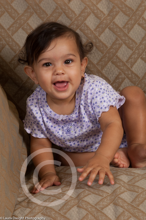 6 month old baby girl smiling happy