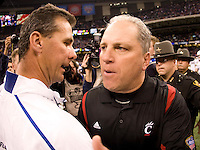 01 January 2010:  Florida head coach Urban Meyer shakes hands with Cincinnati interim head coach Jeff Quinn after the game during Sugar Bowl at the SuperDome in New Orleans, Louisiana.  Florida defeated Cincinnati, 51-24.