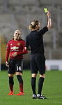 Charlie Devlin of Manchester United Women is yellow carded by referee
