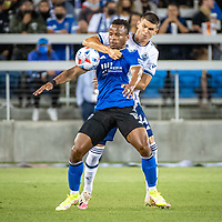 SAN JOSE, CA - AUGUST 13: Jeremy Ebobisse #11 of the San Jose Earthquakes holds off Ranko Veselinovic #4 of the Vancouver Whitecaps during a game between San Jose Earthquakes and Vancouver Whitecaps at PayPal Park on August 13, 2021 in San Jose, California.