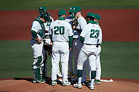 Charlotte 49ers head coach Robert Woodard (20) has a meeting on the mound during the game against the Florida Atlantic Owls at Hayes Stadium on April 2, 2021 in Charlotte, North Carolina. The 49ers defeated the Owls 9-5. (Brian Westerholt/Four Seam Images)
