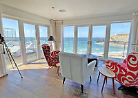 BNPS.co.uk (01202) 558833. <br /> Pic: LillicrapChilcott/BNPS<br /> <br /> A cliffside contemporary home with far-reaching sea views is on the market for £1.2m.<br /> <br /> The aptly-named property, The Lookout, sits on the hill above a pretty sandy beach and with four storeys it makes the most of its beautiful position.<br /> <br /> The house is in the picturesque Cornish village of Portreath on the rugged north Atlantic coastline.<br /> <br /> It is just a short stroll to the beach and has easy access onto the South West Coast Path.