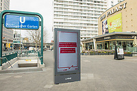 """Die Auswirkungen der Corona-Krise sind nach Inkrafttreten der Anordnung des Berliner Senats, wonach nur noch Versorgungsgeschaefte die fuer den taeglichen Bedarf notwendig sind geoeffnet sein duerfen (Lebensmittelgeschaefte, Apotheken, Drogerien, Zeitungsgeschaefte), im oeffentlichen Leben deutlich sichtbar.<br /> Im Bild: Eine Werbetafel mit einer Oeffentlichkeitskampagne des Berliner Senat, mit der die Bevoelkerung u.a. aufgerufen wird, """"soziale Kontakte auf ein Minimum"""" zu reduzieren um gemeinsam gegen die Verbeitung des Corona-Virus zu kaempfen. Rechts im Biuld das geschlossene Berlinale-Kino """"Zoo Palast"""".<br /> 19.3.2020, Berlin<br /> Copyright: Christian-Ditsch.de<br /> [NUR FUER REDAKTIONELLE ZWECKE! Werbung nur auf Anfrage beim Fotografen. Inhaltsveraendernde Manipulation des Fotos nur nach ausdruecklicher Genehmigung des Fotografen. Vereinbarungen ueber Abtretung von Persoenlichkeitsrechten/Model Release der abgebildeten Person/Personen liegen nicht vor. NO MODEL RELEASE! Don't publish without copyright Christian-Ditsch.de, Veroeffentlichung nur mit Fotografennennung, sowie gegen Honorar, MwSt. und Beleg. Konto: I N G - D i B a, IBAN DE58500105175400192269, BIC INGDDEFFXXX, Kontakt: post@christian-ditsch.de<br /> Bei der Bearbeitung der Dateiinformationen darf die Urheberkennzeichnung in den EXIF- und  IPTC-Daten nicht entfernt werden, diese sind in digitalen Medien nach §95c UrhG rechtlich geschuetzt. Der Urhebervermerk wird gemaess §13 UrhG verlangt.]"""