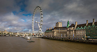 Photograph of the London Eye which is a giant Ferris wheel located on the River Thames in London. This iconic ferris wheel is also known as the Millennium Wheel. Located near Westminister Bridge