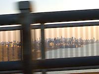 Downtown Manhattan seen through George Washington Bridge guardrails<br />