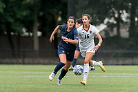 NEWTON, MA - AUGUST 29: Lucy Cappadona #4 of University of Connecticut brings the ball forward as Samantha Agresti #15 of Boston College ;cls during a game between University of Connecticut and Boston College at Newton Campus Soccer Field on August 29, 2021 in Newton, Massachusetts.