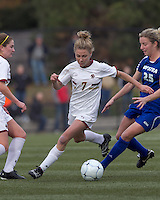 Boston College forward Amy Caldwell (7) brings the ball forward as Hofstra University midfielder Brittany Butts (25) pressures. Boston College defeated Hofstra University, 3-1, in second round NCAA tournament match at Newton Soccer Field, Newton, MA.