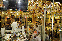 Sellers wait for customers to buy jewelry in Calcutta. Gold for weddings is an important Indian custom.