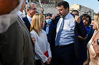 The leader of Lega right party Matteo Salvini (r) jokes with the leader of  Fratelli d Italia right party Giorgia Meloni showing her his ironed shirt as they prepare to attend an electoral campaign press conference for the mayoral election in Spinaceto, a peripheral neighborhood in the west of Rome on October 1st 2021. Photo Andrea Staccioli Insidefoto