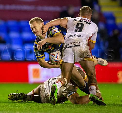 13th November 2020; The Halliwell Jones Stadium, Warrington, Cheshire, England; Betfred Rugby League Playoffs, Catalan Dragons versus Leeds Rhinos; A loose arm of Michael Mcllorum of Catalans Dragons strikes the face of Brad Dwyer of Leeds Rhinos