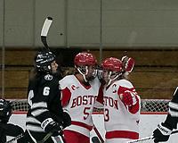 Boston, Massachusetts - January 12, 2019: NCAA Division I. Boston University (white) defeated Providence College, 4-2, at Walter Brown Arena.Goal celebration.