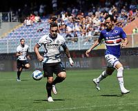 12th September 2021; G.Ferraris Stadium, Genoa, Italy; Serie A football, Sampdoria versus Inter Milan; Lautaro Martinez of Inter holds off Maya Yoshida of Sampdoria