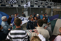 """State College, PA -- 10/25/2007 -- Penn State students camp outside of Beaver Stadium in hopes to be near the front of the student section for the game against Ohio State this Saturday.  The gathering of tents outside of the student entrance to the stadium has been dubbed """"Paternoville"""" and received a visit from its namesake, Joe Paterno, and his wife, Sue, this morning.  The Paterno's delivered pizza to the students and thanked them for their support of the football team...Photo:  Joe Rokita / JoeRokita.com"""